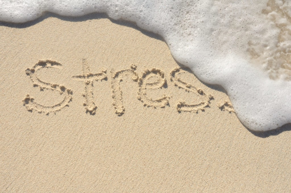 Stress written on a beach