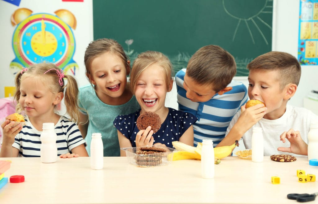 children snacking and eating calories